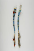 American Indian Art:Beadwork and Quillwork, TWO PLAINS BEADED HIDE AWL CASES. c. 1880. ... (Total: 2 Items)