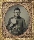Military & Patriotic:Civil War, 1/6 Plate Tintype Union Civil War Enlisted Man Displaying his Very Large Hardtack. Unidentified soldier wearing a frock coat...