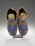 American Indian Art:Beadwork and Quillwork, A PAIR OF SIOUX BEADED HIDE MOCCASINS. c. 1910. ... (Total: 2Items)