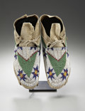 American Indian Art:Beadwork and Quillwork, A PAIR OF SIOUX BEADED HIDE MOCCASINS. c. 1890... (Total: 2 Items)