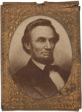 "Political:Ferrotypes / Photo Badges (pre-1896), Abraham Lincoln: Pin-Back Campaign Photo Badge, .75"" x 1"". Albumencardboard or paper photo in ""gem"" sized brass shell frame..."