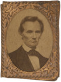 "Political:Ferrotypes / Photo Badges (pre-1896), Abraham Lincoln: Pin-Back Campaign Photo Badge, .75"" x 1"". Albumen cardboard or paper photo in ""gem"" sized brass shell frame..."