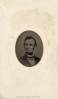 Photography:Tintypes, Abraham Lincoln: An 1864 Berger Image in Seldom Seen Tintype Form.Set into original carte de visite mount. While this p...