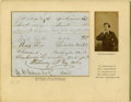 "Autographs:Celebrities, John Wilkes Booth Autograph Signature and place of residence (""J Wilkes Booth Baltimore"") neatly penned on a piece of pa..."