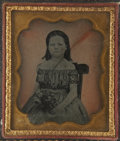 Photography:Studio Portraits, Ambrotype Portrait of a Young Girl Seated in a Chair, in original brass mat and preserver, folding embossed paper case (brok...