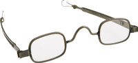 A Pair of Spectacles that Belonged to Abraham Lincoln, made of a zinc-colored metal, adjustable frames, open loop ter
