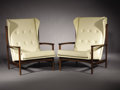 Furniture : Continental, DANISH MODERN. A Pair of Upholstered Teak High-Back Lounge Chairs, imported by Selig, circa 1960. Marks: round Selig metal t... (Total: 2 Items)
