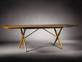 Furniture : Continental, HANS J. WEGNER (Danish, 1914-2007). A Teak and Oak Drop-Leaf Dining Table, manufactured by Andreas Tuck, circa 1952. Branded...