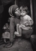 Photography :20th Century , W. EUGENE SMITH (American, 1918-1978). Mother and Child, Spanish Village, 1950. Silver gelatin, circa 1970. Paper: 10 x ...