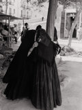 Photography :20th Century , TODD WEBB (American, 1905-2000). Women Whispering in Marketplace, Ibiza, Spain, 1951. Silver gelatin, 1951. 13 x 10 inch...