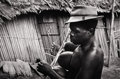 Photography :20th Century , W. EUGENE SMITH (American, 1918-1978). Man Playing Gourd, Alfred Schweitzer Leper Colony, Africa, circa 1960. Silver gel...