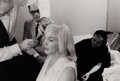 Photography :20th Century , BRUCE DAVIDSON (American, b. 1933). Marilyn Monroe (getting her hair fixed) with Arthur Miller, circa 1960. Silver gelat...