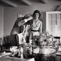 Photography :20th Century , HY PESKIN, American 1915-2005. Jackie and JFK (Fixing His Hair at Breakfast), circa 1950s. Silver gelatin, circa 1950s. ...