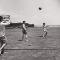 Photography :20th Century , HY PESKIN (American, 1915-2005). Kennedys Playing Ball, 1950s. Silver gelatin, 1950s. 18 x 8 inches (45.7 x 20.3 cm). Ve... (Total: 2 Items)