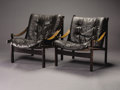 Furniture : Continental, Attributed to OLE WANSCHER (Danish, 1903-1985). A Pair of Rosewoodand Leather Upholstered Lounge Chairs, circa 1968. 30-1/4...(Total: 2 Items)