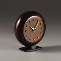 GILBERT ROHDE (American, 1894-1944) A Brazilian Rosewood Table Clock, model no. 4738, manufactured by Herman Mille
