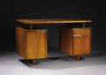 """Furniture : American, GILBERT ROHDE (American, 1894-1944). A Walnut Desk from the """"AllWalnut"""" Group, model no. 3977, manufactured by Herman Mille..."""