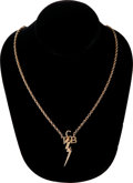 "Music Memorabilia:Memorabilia, Elvis Presley Gold ""TCB"" Necklace with Leather Box. ..."