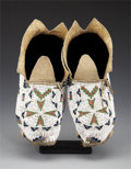 American Indian Art:Beadwork and Quillwork, A PAIR OF CHEYENNE BEADED HIDE MOCCASINS. c. 1900... (Total: 2 Items)