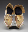 American Indian Art:Beadwork and Quillwork, A PAIR OF SIOUX BEADED AND QUILLED HIDE MOCCASINS. c. 1880... (Total: 2 Items)