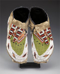 American Indian Art:Beadwork and Quillwork, A PAIR OF PLAINS BEADED HIDE MOCCASINS. c. 1910... (Total: 2 Items)