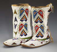 A MATCHED PAIR OF SIOUX WOMAN'S BEADED HIDE LEGGING c. 1920
