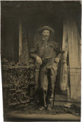 Photography:Tintypes, Sixth Plate Tintype of a Cowboy in Fringed Leather Chaps With Revolver....