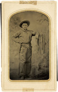 Photography:Tintypes, Sixth Plate Tintype of a Young Cowboy With Pistol Dressed inFringed Buckskin Shirt and Leather Chaps....