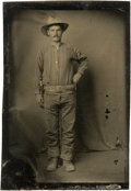 Photography:Tintypes, Sixth Plate Tintype of an Armed Cowboy....