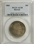 Coins of Hawaii: , 1883 50C Hawaii Half Dollar AU58 PCGS. Deep dove-gray toningblankets this well struck Hawaiian half. The devices exhibit m...