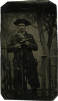 Photography:Tintypes, Sixth Plate Tintype of a Cowboy Holding Two Pistols....