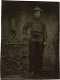 Photography:Tintypes, Sixth Plate Tintype of Cowboy in Fringed Clothing and With LargeRevolver....