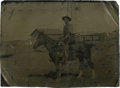 Photography:Tintypes, Quarter Plate Tintype of an Armed Cowboy on Horseback....