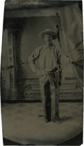 Photography:Tintypes, Sixth Plate Tintype of Cowboy Wearing a Revolver....