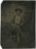 Photography:Tintypes, Sixth Plate Tintype of Seated Cowboy With Pistol....