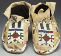 American Indian Art:Beadwork and Quillwork, A PAIR OF CHEYENNE BEADED HIDE MOCCASINS. c. 1920... (Total: 2Items)