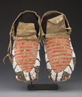 American Indian Art:Beadwork and Quillwork, A PAIR OF SIOUX BEADED AND QUILLED HIDE MOCCASINS. c. 1900. ...