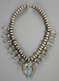American Indian Art:Jewelry and Silverwork, A NAVAJO SILVER AND TURQUOISE SQUASH BLOSSOM NECKLACE. c. 1970...