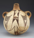 American Indian Art:Pottery, A HOPI POLYCHROME CANTEEN. c. 1900...