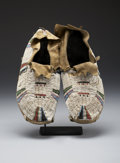 American Indian Art:Beadwork and Quillwork, A PAIR OF CHEYENNE BEADED HIDE MOCCASINS. c. 1900... (Total: 2Items)
