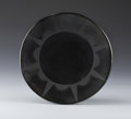 American Indian Art:Pottery, A SAN ILDEFONSO BLACKWARE PLATE. Maria Martinez. c. 1925...