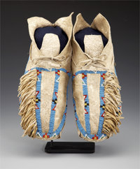 A PAIR OF SOUTHERN CHEYENNE BEADED HIDE MOCCASINS c. 1900