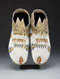 American Indian Art:Beadwork and Quillwork, A PAIR OF CHEYENNE BEADED HIDE MOCCASINS. c. 1915... (Total: 2Items)