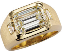 Gentleman's Diamond, Gold Ring  The ring centers one emerald-cut diamond measuring 12.93 x 9.09 x 6.26 mm and weighing 7...