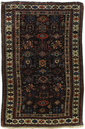 Rugs & Textiles:Carpets, An Antique Kuba Shirvan Carpet. Caucasian, Circa 1900. Wool. 68.5inches x 48.5 inches. Woven with dark brown background...