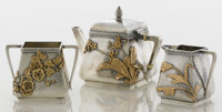 AN AMERICAN SILVER AND MIXED METALS THREE-PIECE TEA SET Gorham Manufacturing Co., Providence, Rhode Island, 1880