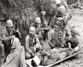 Photography :20th Century , W. EUGENE SMITH (American, 1918-1978). Soldiers Surround Wounded Soldier While Awaiting Evacuation at the Foot of Rocky Cr...