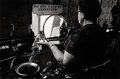 Photography :20th Century , W. EUGENE SMITH (American, 1918-1978). Woman Dumping Jack Daniel's, Pittsburgh. Vintage gelatin silver. Paper: 11 x 14 i...