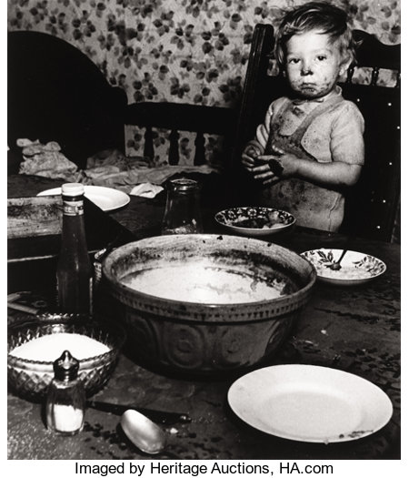BILL BRANDT (British, 1904-1983) London (Little Boy Eating), circa 1937 Early gelatin silver on single weight glossy p...