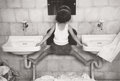 Photography :20th Century , RUTH ORKIN (American, 1921-1985). Tirza on Sinks, 1951. Gelatin silver, posthumous print. Paper: 11 x 14 inches (27.9 x ...